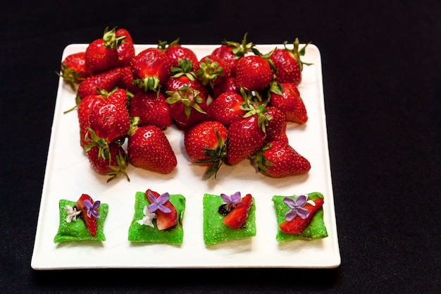 Strawberries chopped and whole for decoration banquet platter for events and buffets catering