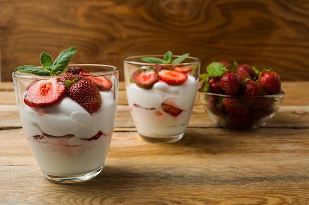 Strawberries cream cheese dessert on wooden background