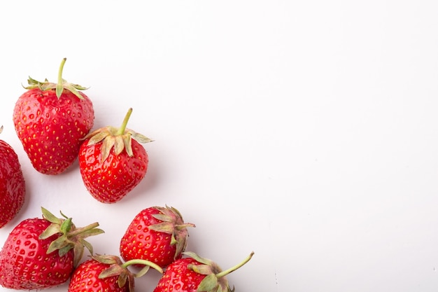 Strawberries isolated on white background, top view, copy space