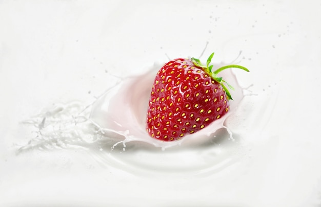 Strawberries in milk with splashes