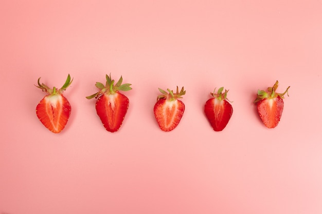 Strawberries on pink background. fresh organic food concept