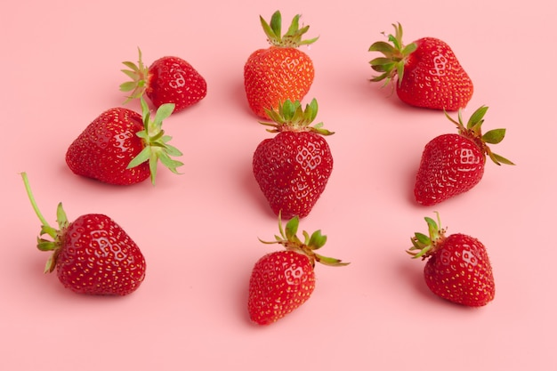 Strawberries on pink , fresh organic food concept