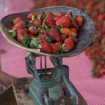 Strawberries on traditional set of scales, arcos de san miguel, san miguel de allende, guanajuato, m