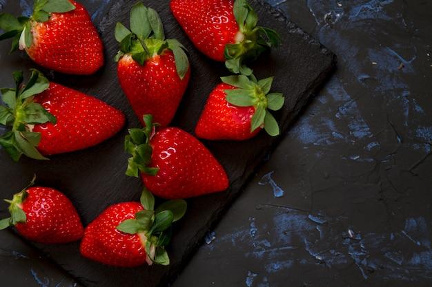 Strawberries with dark background