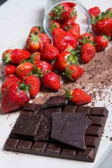 Strawberries with a dark chocolate bar