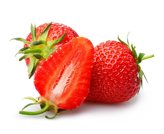 Strawberries with leaves and slices isolated on a white