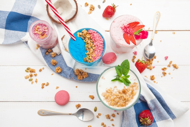 Strawberries and yoghurt breakfast on table