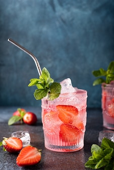 Strawberry alcoholic cocktail with fresh mint, close-up