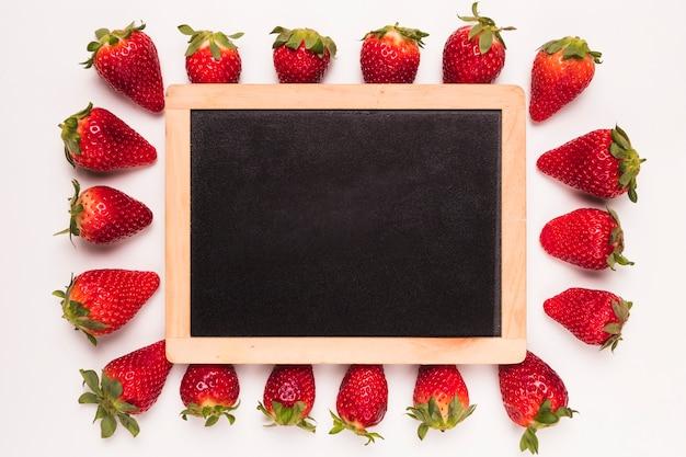 Strawberry and blackboard in center