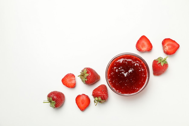 Strawberry and bowl with jam on white, space for text