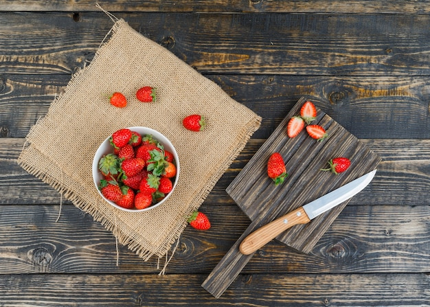 Strawberry in bowl with knife
