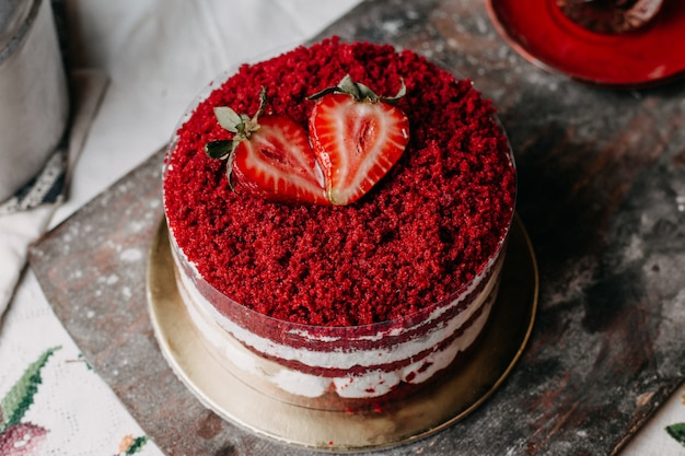 Strawberry cake red powdered sweet delicious round on grey desk
