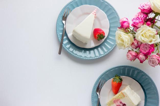 Strawberry cake and spring tulip flowers. beautiful breakfast