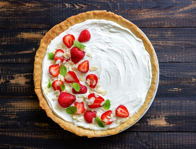 Strawberry cake with mascarpone cheese, almonds and mint. tart. cheesecake. pie. vegetarian food. recipe.
