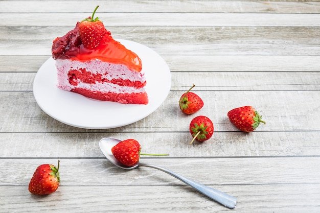 Strawberry cake on a wooden table