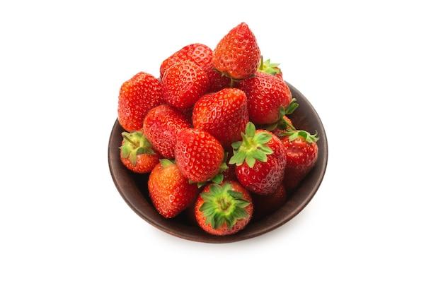 Strawberry in ceramic brown bowl