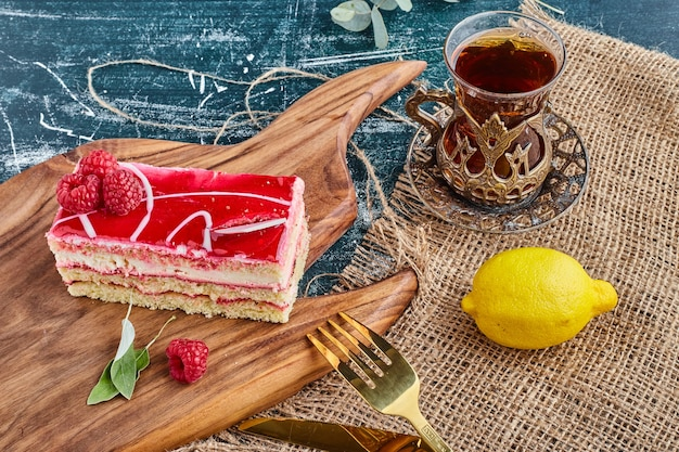 Strawberry cheesecake with a glass of tea.