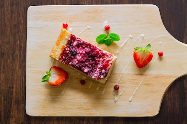 Strawberry cheesecake on wood background