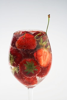 Strawberry and cherry in water