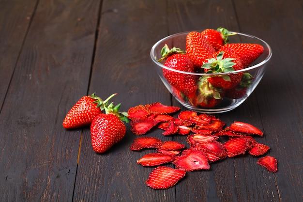Strawberry chips and fresh strawberries