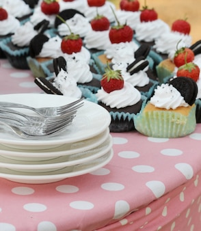 Strawberry on chocolate cake outdoor, wedding cake