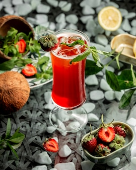 Strawberry cocktail garnished with strawberry and mint