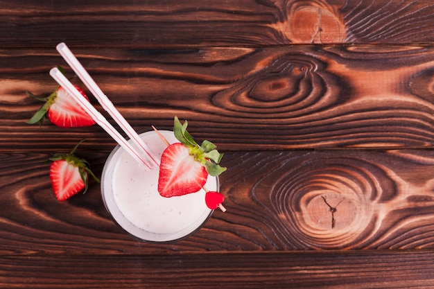 Strawberry cocktail on wooden surface