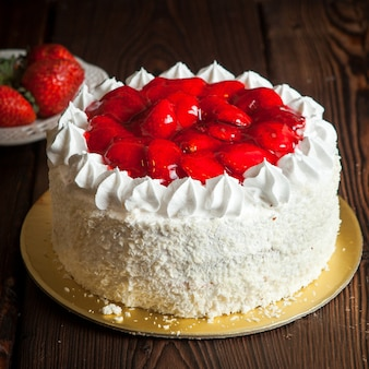 Strawberry fruit cake and fresh strawberry on wooden table