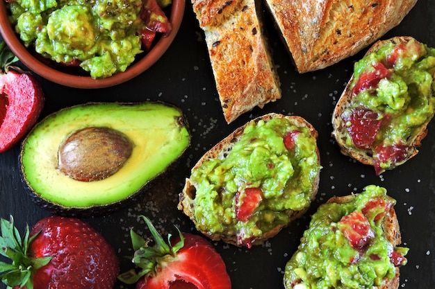 Strawberry guacamole with fitness baguette. healthy snack. keto diet keto snack.