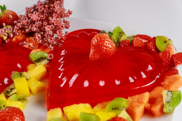 Strawberry heart gelatin with fruits and flowers on valentines day