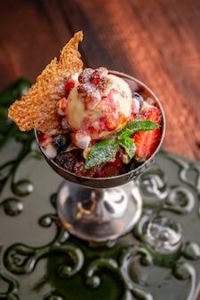 Strawberry ice cream balls with marshmallows