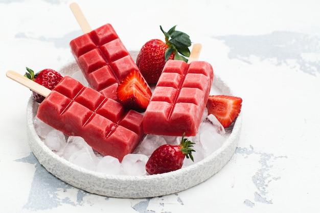 Strawberry ice cream popsicles