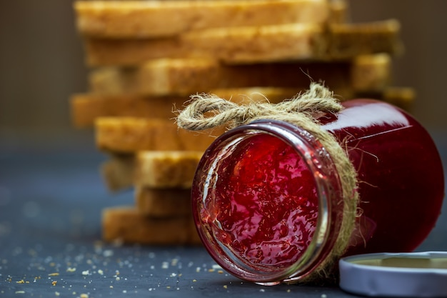 Strawberry jam bottle and whole wheat bread
