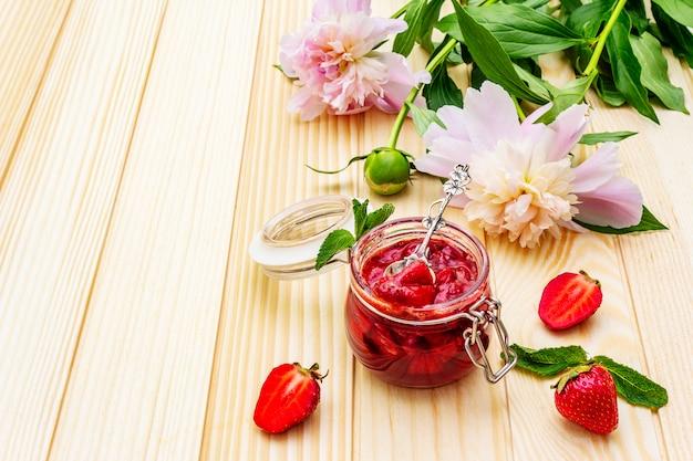Strawberry jam in a glass jar.