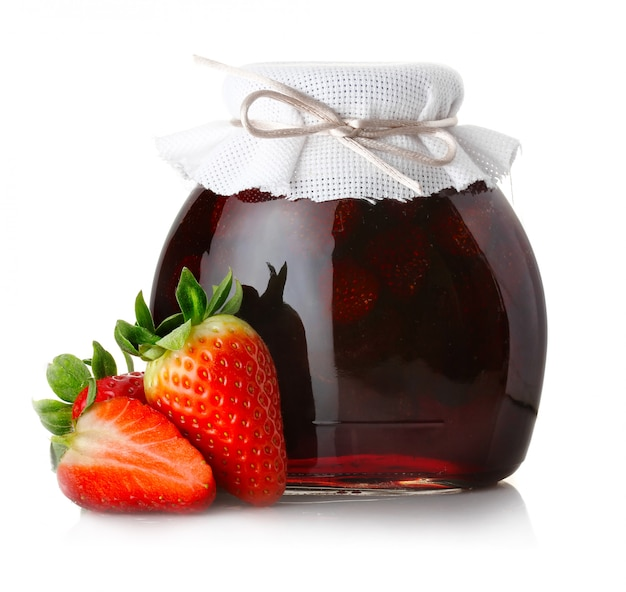 Strawberry jam with ripe strawberries isolated on white