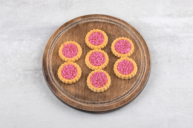 Strawberry jelly biscuits on a board, on the marble.