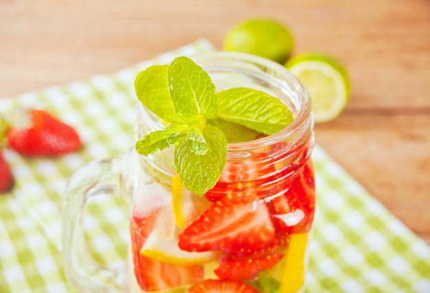 Strawberry lemonade or mojito cocktail with lemon and mint