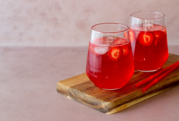 Strawberry lemonade on a pink background . cold drinks. summer. recipe.