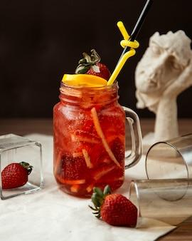 Strawberry lemonade  with orange peels  side view