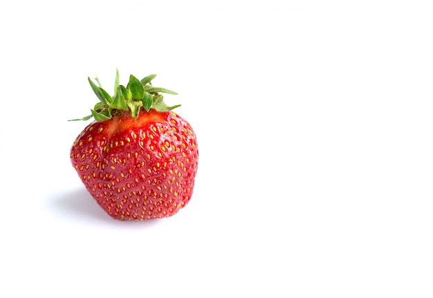 Strawberry lies on a white