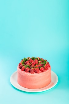 Strawberry mascarpone cake with fresh berries and rosemary leaves