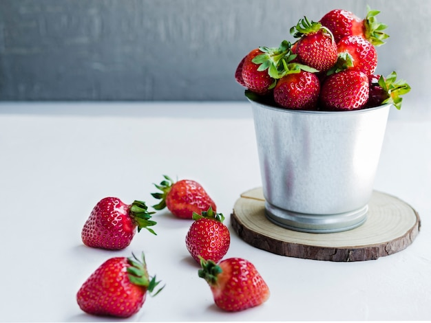 Strawberry in metal bucket