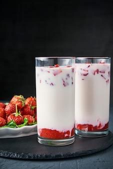 Strawberry milk smoothie in glasses