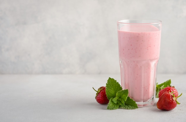 Strawberry milkshake on a gray concrete