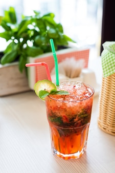 Strawberry mojito cocktail on wooden table