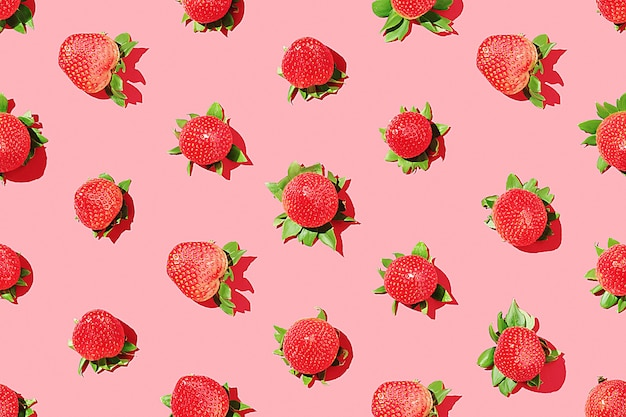 Strawberry pattern on a pink background. juicy strawberries. top view.