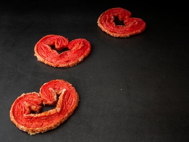 Strawberry puff heart-shaped on granite board