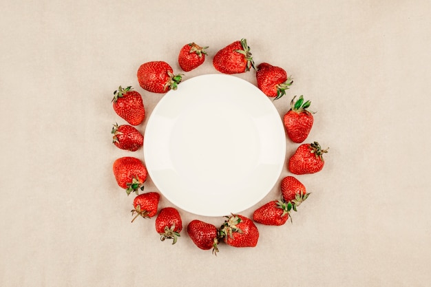 Strawberry round frame and empty white plate