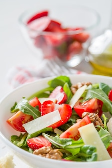 Strawberry salad in white bowl