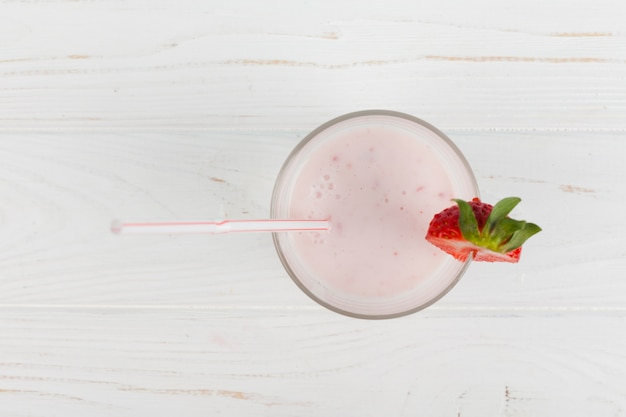 Strawberry shake on wooden background